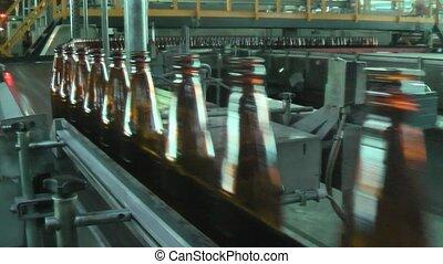 Glass bottle factory in Tyumen. Russia - Many bottles on...