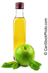 Glass bottle of apple vinegar with green apple in the leaves...
