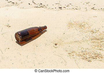 Glass bottle on the beach