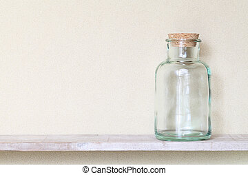 glass bottle - Old glass bottle on a shelf