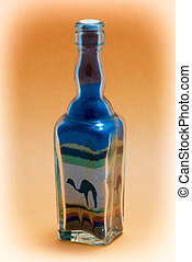 Glass bottle with decorative sand