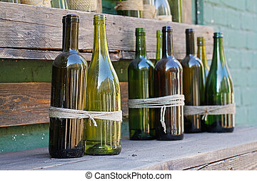 Glass bottles decorated with twine in wooden boxes