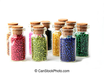 Glass bottles filled with beads