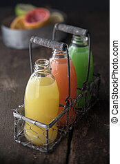 Glass bottles of assorted fresh fruit juice