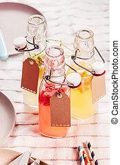 Glass bottles of healthy fresh fruit juice
