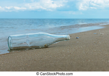 Glass bottles on the beach