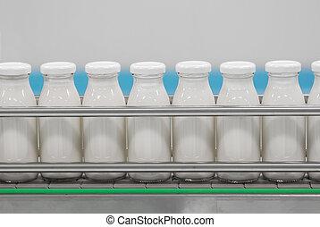 Glass bottles on the conveyor belt