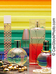 Glass bottles with perfumery. On a color background with reflection...