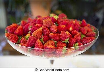 Glass bowl full of strawberries