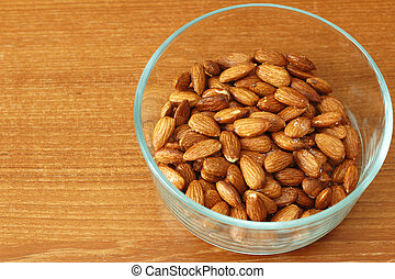 Glass Bowl of Maple Glazed Almonds - Baked maple syrup...