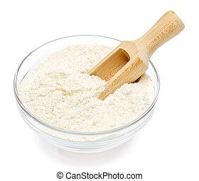 Glass bowl of wheat flour