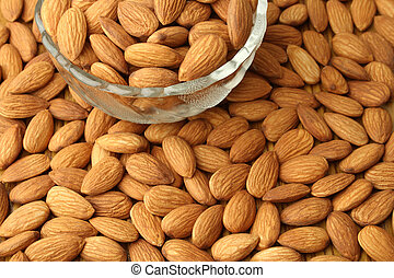 Glass bowl with almonds