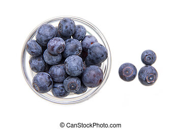Glass bowl with blueberries on white background top view