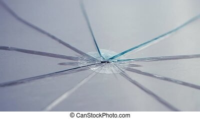 Glass broken into pieces spinning on the table. Close up -...