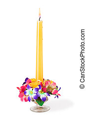 Glass candlestick with flowers, isolated on white