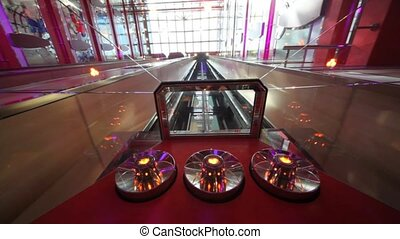 glass ceiling of elevator moving down in multilevel interior of cruise ship