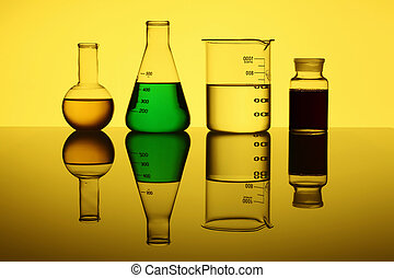 Glass chemistry tubes on a colour background