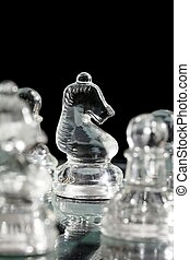 glass chess knight with pawn