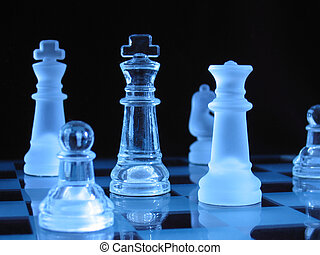 Glass Chessmen - Glass chessmen during a play against dark...