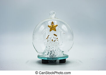 Glass Christmas tree with golden star inside a crystal bauble.