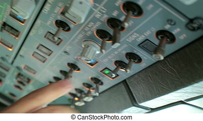 Glass cockpit cabin. Pilot hands operating on electronic...