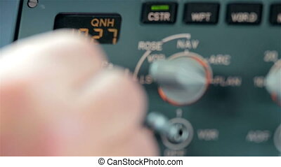 Glass cockpit cabin door flight deck. Pilot hands operating electronic gadgets and switch controls panel of aircraft, preparation for take off or landing on Airbus A319 A320