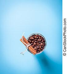 Glass coffee cup with cinnamon