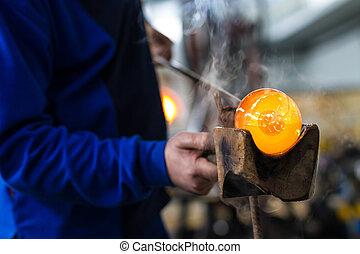 Glass crafting worker make glass souvenir - Glass blower...