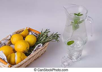 Glass cup ang jug with mint water.