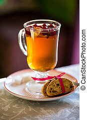 glass Cup of fruit tea with biscuits
