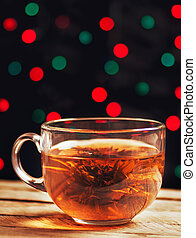 Glass cup of green tea with flower