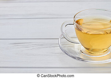 Glass cup with green tea.