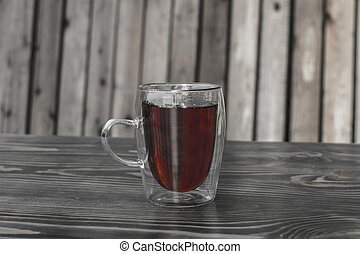 glass cup with tea on a wooden table