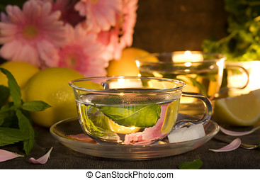 mint tea - glass cups of mint tea with lemons and gerbera...