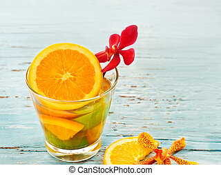 glass delicious refreshing drink of mix fruits orang and...