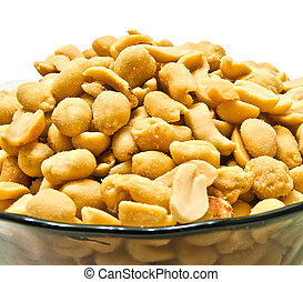 glass dish with peanuts on white background