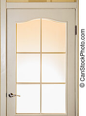 A glass door with a strong light behind it