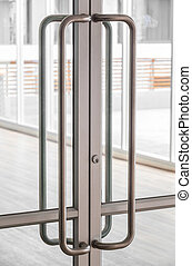 Glass door handle - Close up big stainless steel door handle...
