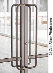 Glass door handle - Close up big stainless steel door handle...