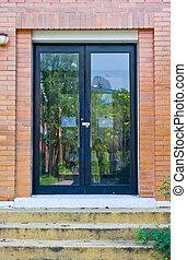 Glass door in brick wall
