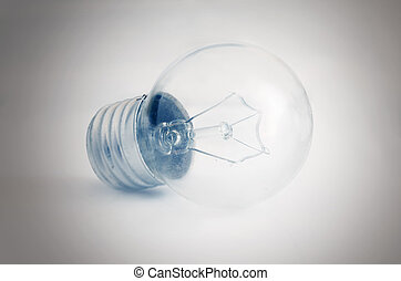 Glass electrical bulb on a light background with shading at the edges (2).