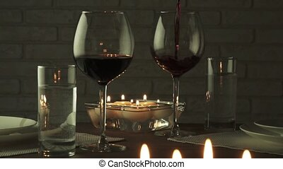 Glass filled with red wine at candlelight romantic evening slow motion stock footage video