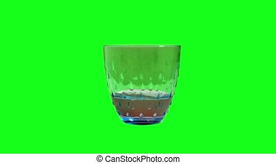 Glass fills with water on the green screen