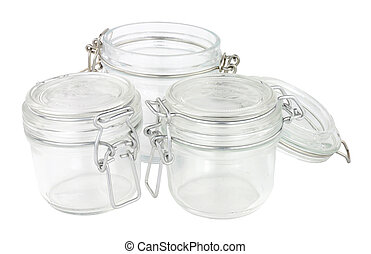 Empty glass food storage jars isolated on a white background