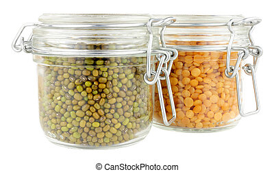 Glass food storage jars filled with green lentils isolated on a white background