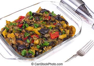 Glass form with baked vegetables. Vegetarian food