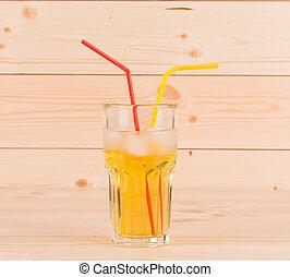 Glass full of apple juice.