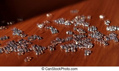 Glass gems on the wooden table