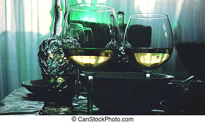 Glass glasses on a table in a restaurant, banquet table, glasses of wine stage green lighting.
