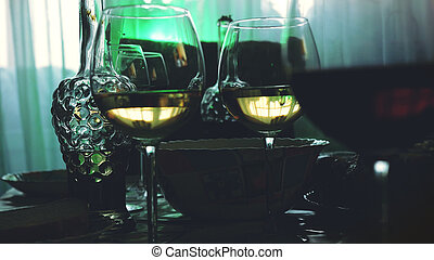Glass glasses on a table in a restaurant, banquet table,...